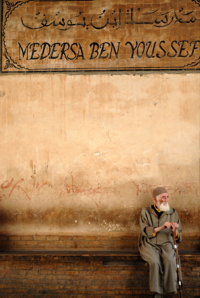 Medersa Ben Youssef - old man sitting