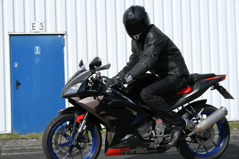 Men in black on bike