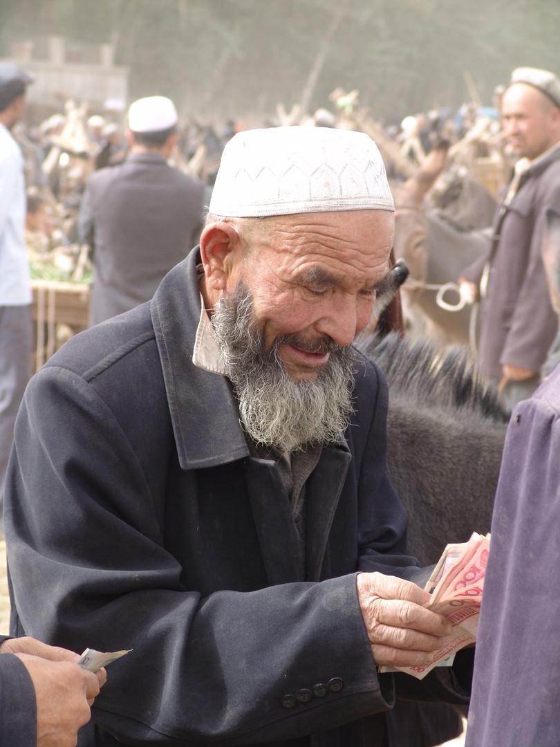 Men with money, Kashgar, Kirgistan/Kirgisien