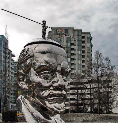 Miss Mao Trying to Balance Herself on Lenin's Head