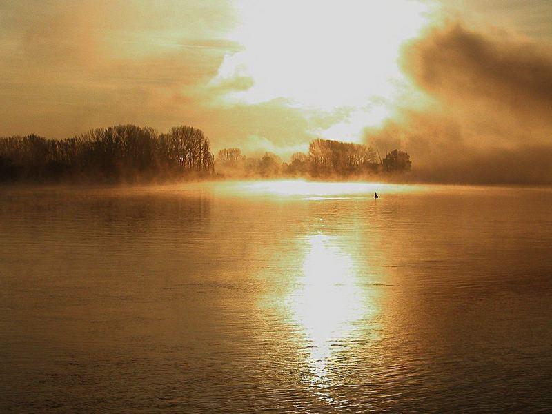 Misty sunrise over river