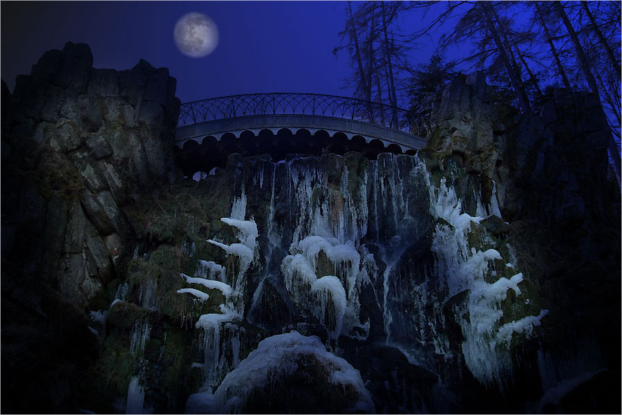 Moonlight over ice cold rocks