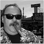 Mr. Hall enjoys his cigar!
