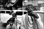 Mumbay - Parcheggiatore abusivo