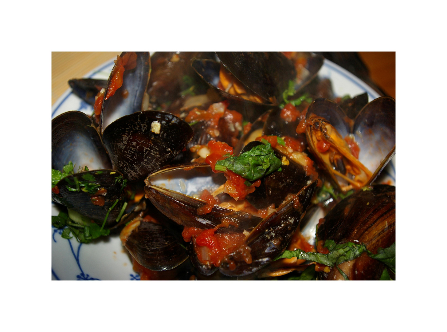 Muscheln in Tomatensauce (frz. Moules sauce tomate')