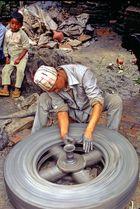 Newa man does pottery