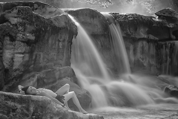 nude photo with a long exposure of a waterfall