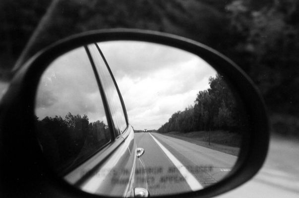 Objects in the rear view mirror appear closer than they