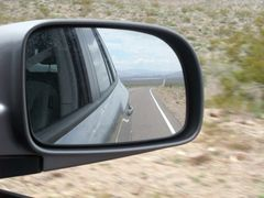 Objects in the rear view mirror may appear closer than they are ... Objects ??? What objects?