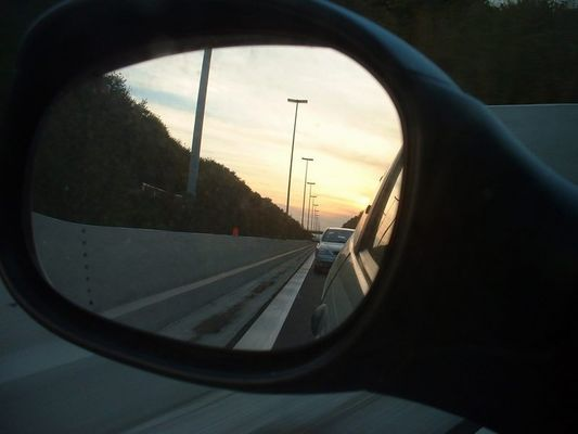 Objects in the rearview mirror may appear closer than they are....
