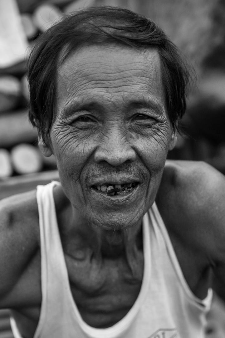 Old man at the river in mandalay