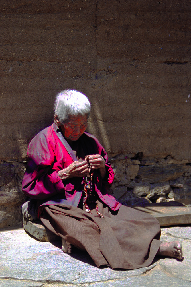 Old nun spins her mala