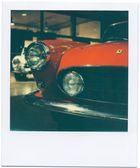 old red Ferrari / Polaroid SX70 - Impossible
