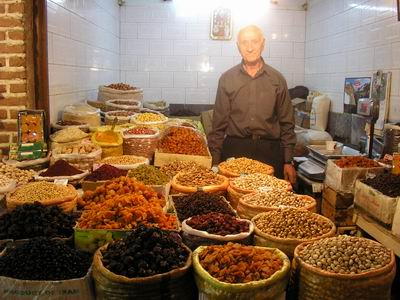 Old salesman at Ardabil Bazaar, selling dreid fruits