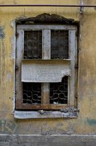 Old window with a sign.Vasilievsky Island.