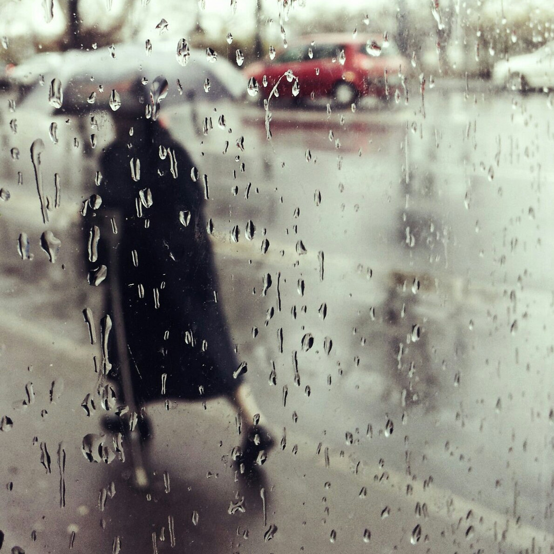 old woman in the rain