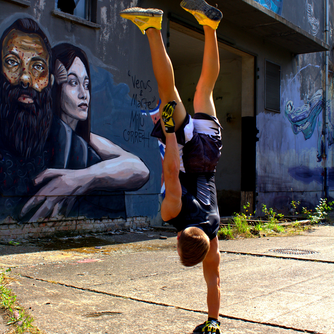 one-armed handstand