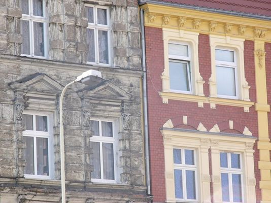 part of destruction after II world war in poland....and new part of the same building after renovati