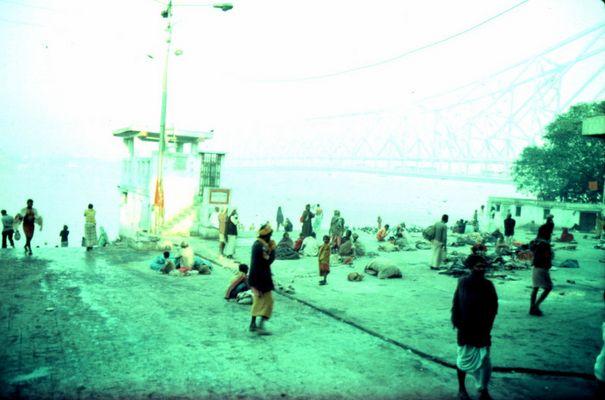 People scattered alongside Ganga