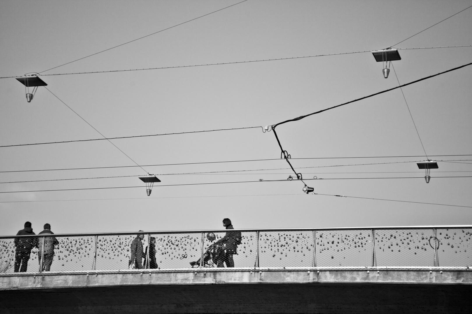 people_on_bridge_graz