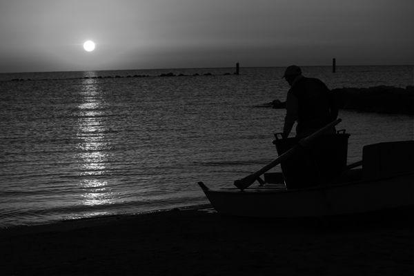 Pescatore all'alba