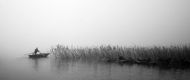 Pescatore nella nebbia
