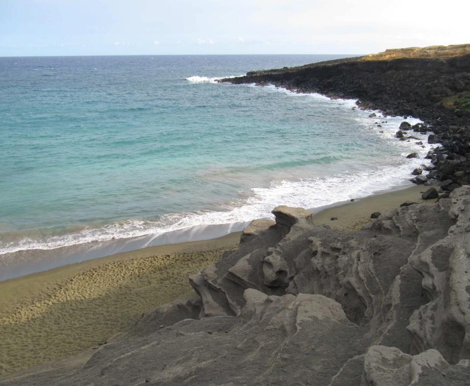 Playa de arena verde
