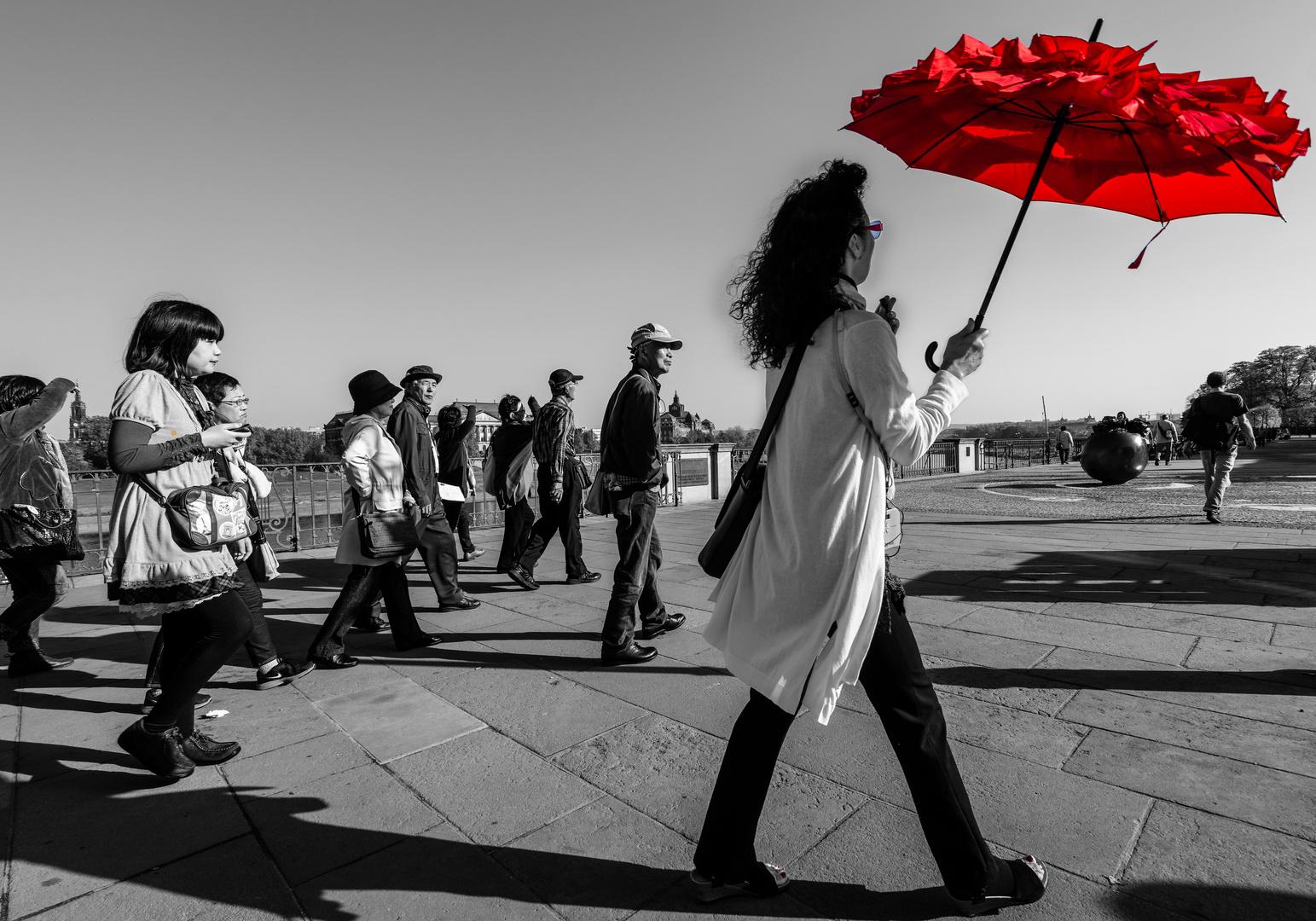 please follow the red umbrella