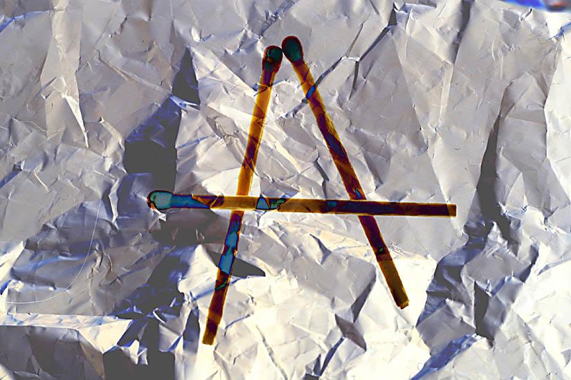 Polarisations - Streichholz - Symmetrie