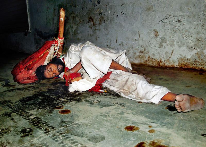 Poor Beggar sleep on the main road,Layyah,Pakistan.