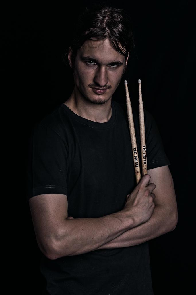 Portrait with drumsticks