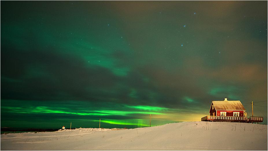 Powerful Aurora behind the clouds