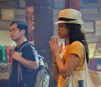 Praying in Man Mo Temple