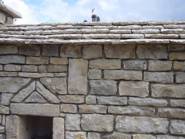 réalisation d'une toiture en lauze