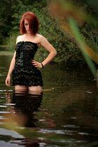 red hair at lake