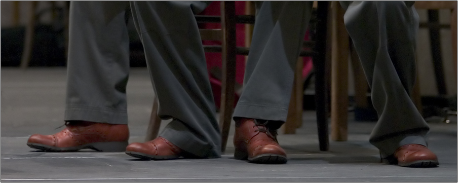 Red Shoes And Grey Trousers