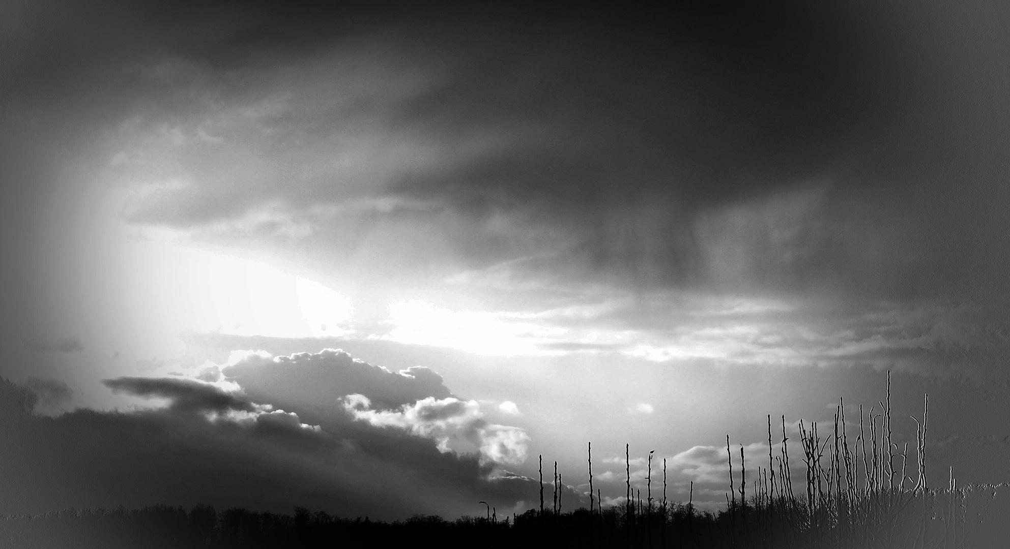 Regenwolke gegen Sonne
