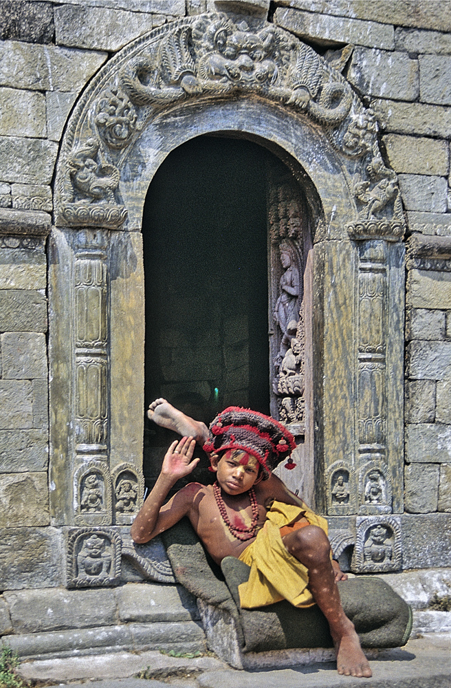Sadhu boy in Pashuaptinath in front of the Shiva temple