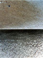 Sand in Edelstahlrinne