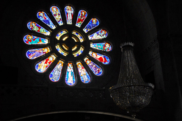 Santa Luzia Church - stained-glass window and the chandliar