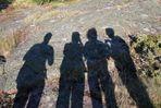 Schatten von vier Fotografen