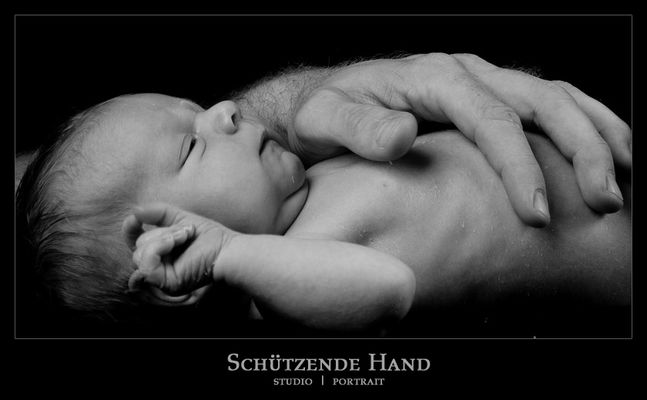 schützende Hand