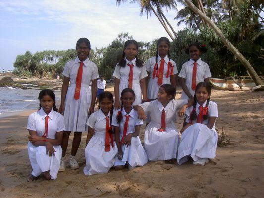 Schulklasse am Palmenstrand