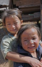 Small Hmong kids looking in the camera