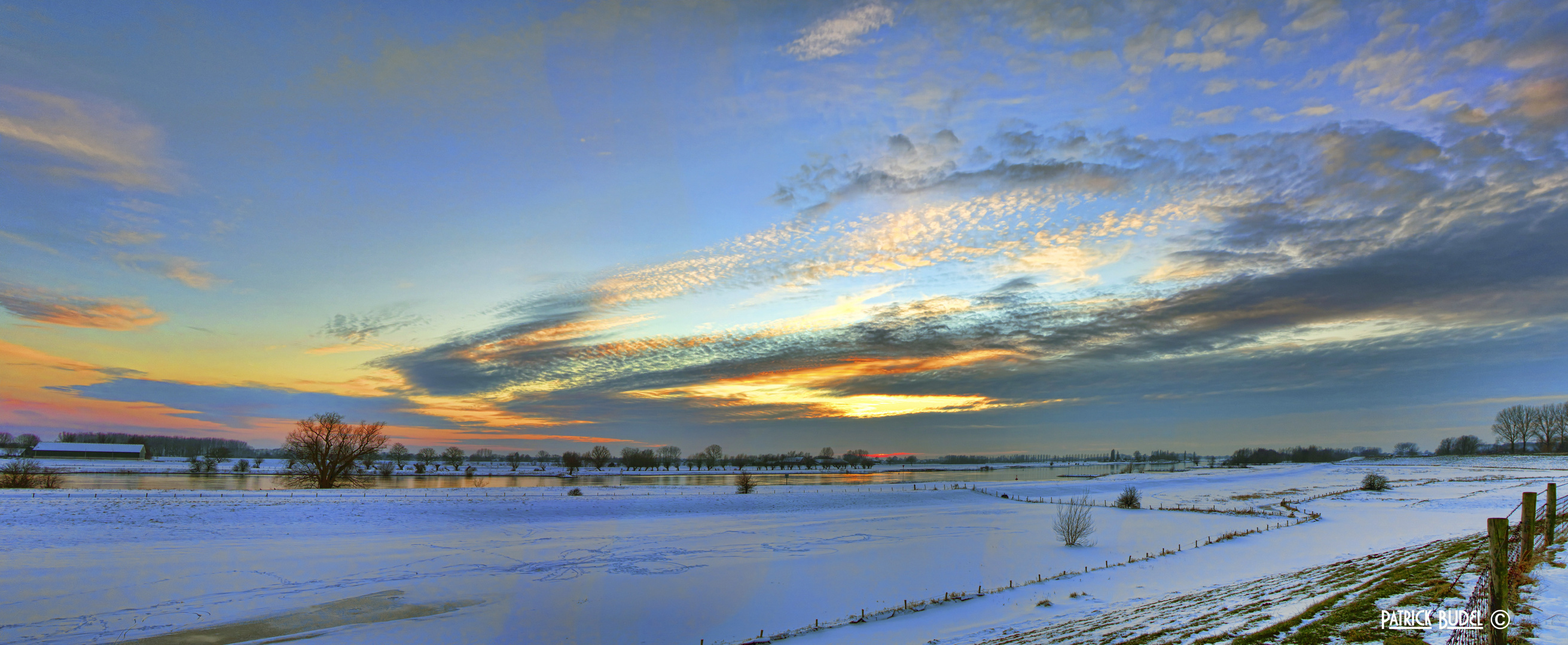 Snowy sunset panorama.