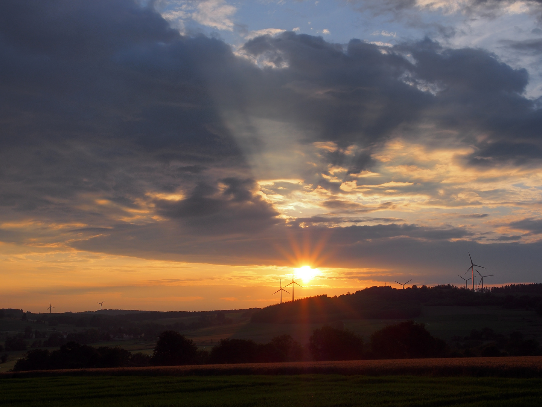 Sonne gegen Windmühlen
