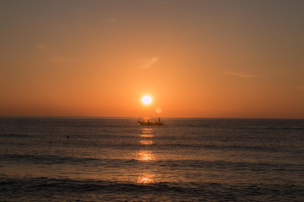 Sonnenaufgang mit Fischerboot 2