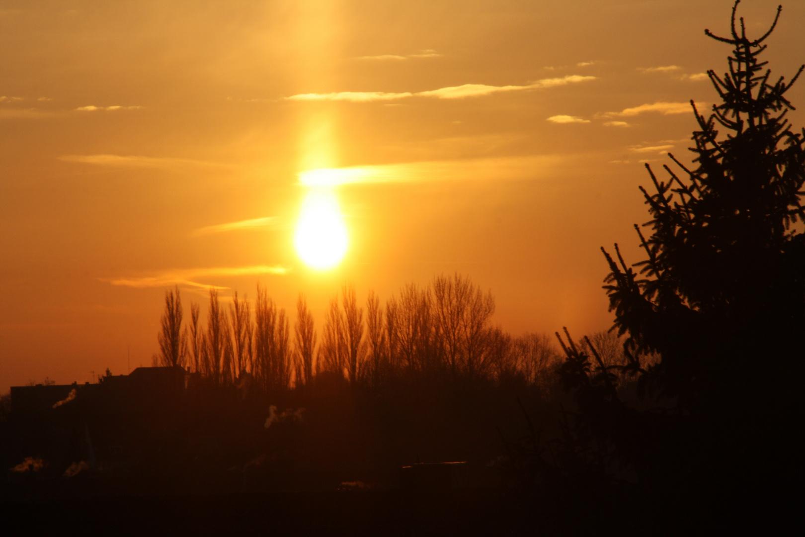 Sonnenaufgang über den Dächern