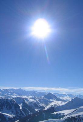 sonnenball über kitzbüheler alpen