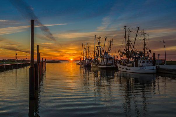 Sonnenuntergang am Wremer Kutterhafen